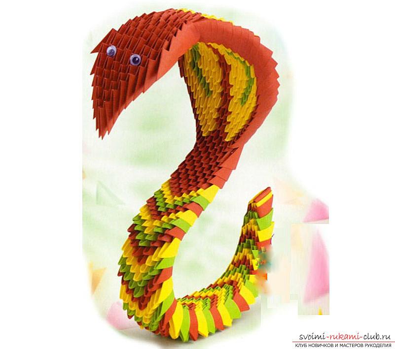 Как создать поделку в технике модульного оригами - змейка, пошаговые фото и подробное описание процесса создания модуля и поделки в целом. Фото №1