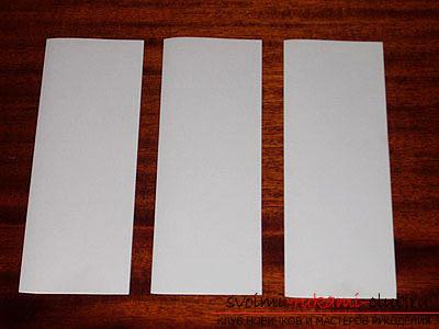 фото примеры процесса изготовления ажурной ёлочки из бумаги. Фото №9