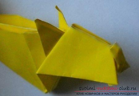 Объемная фигура собаки в технике оригами. Фото №4