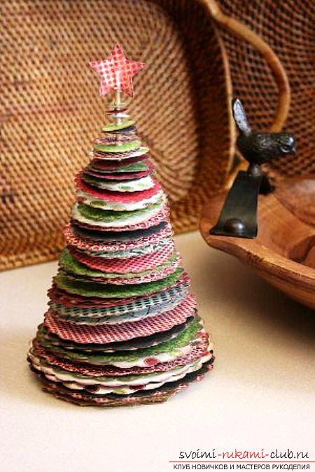 Украсить дом к Новому году вы сможете при помощи сделанной своими руками елки из бумаги