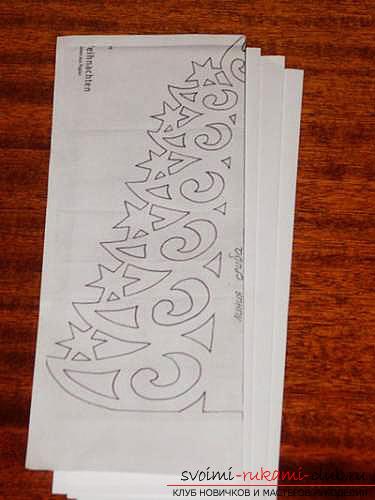 фото примеры процесса изготовления ажурной ёлочки из бумаги. Фото №11