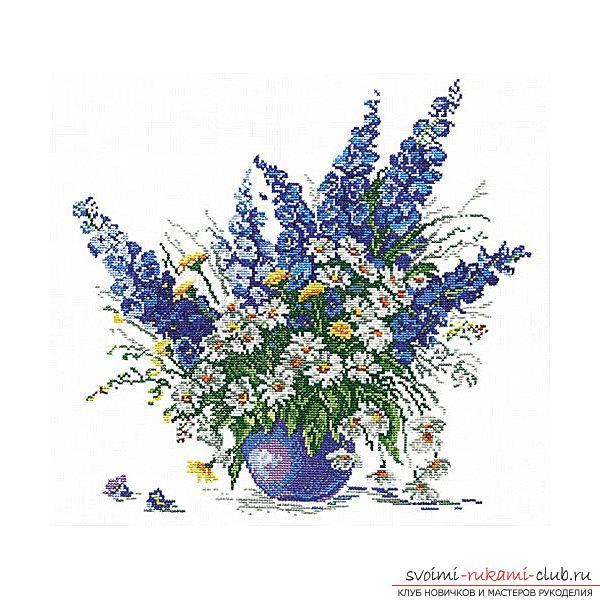 Вышивка крестом различных цветов в вазоне по бесплатным схемам. Фото №1
