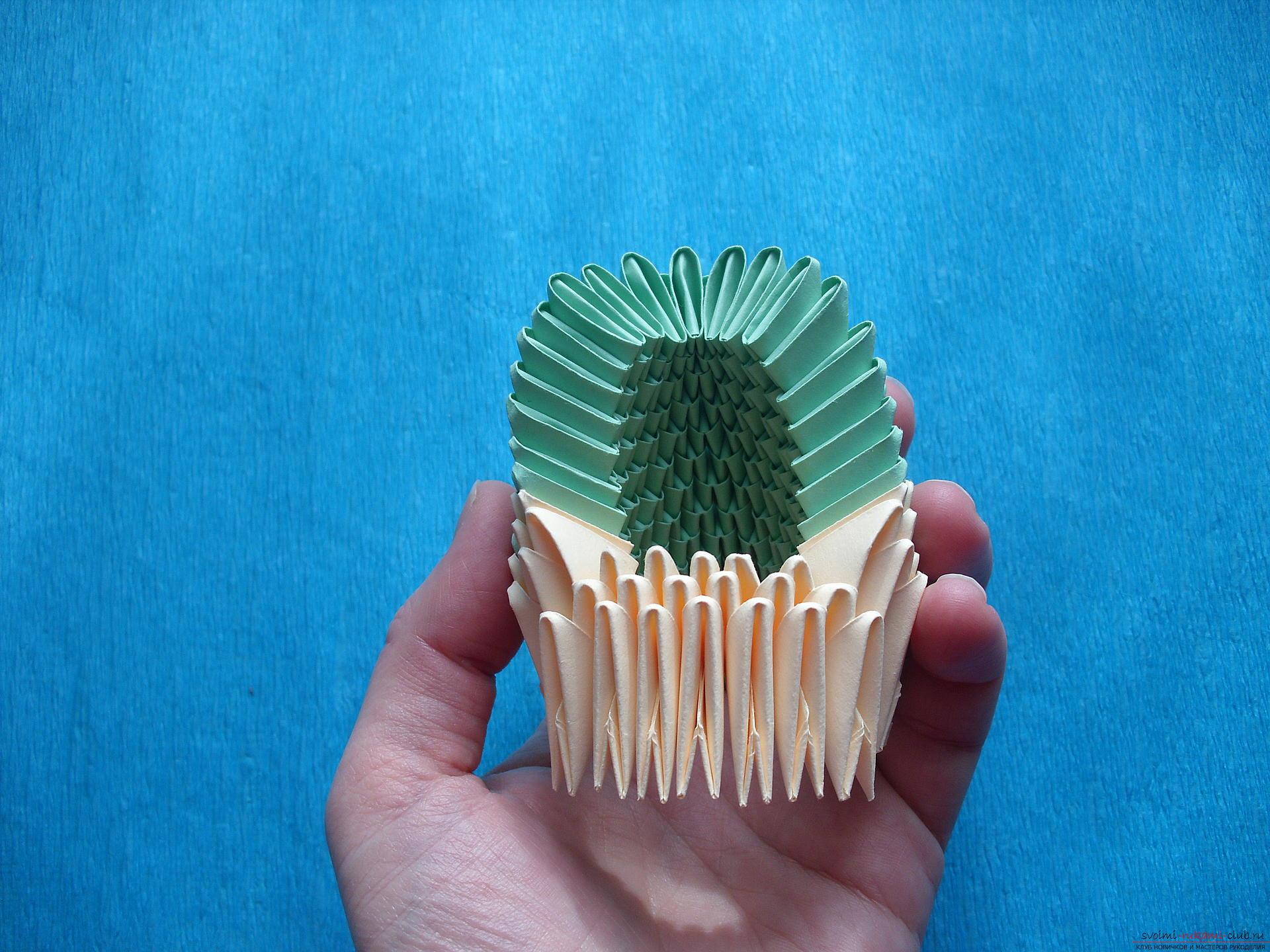 Этот мастер-класс расскажет как сделать поделку из модульных оригами - лягушку.. Фото №10
