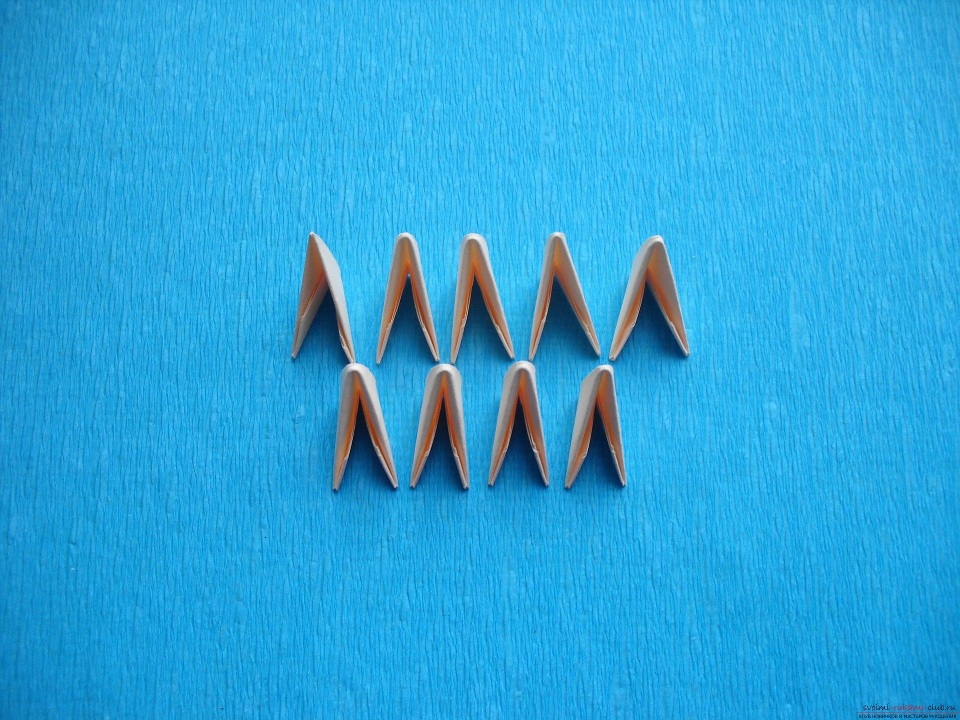 Этот мастер-класс расскажет как сделать поделку из модульных оригами - лягушку.. Фото №6