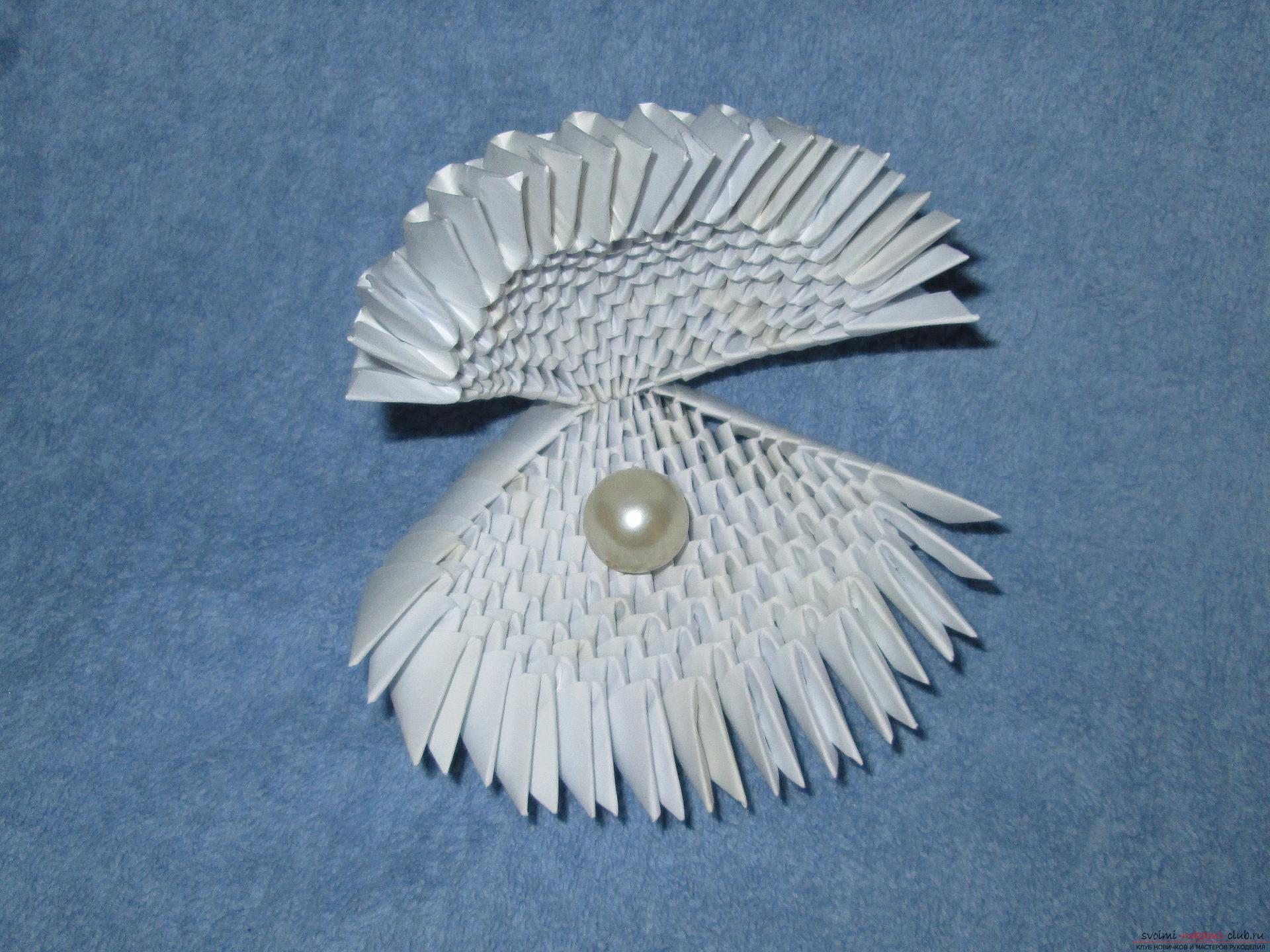 Ракушка для упаковки небольшого подарка собрана в технике модульное оригами в нашем мастер-классе с описанием и фото.. Фото №1